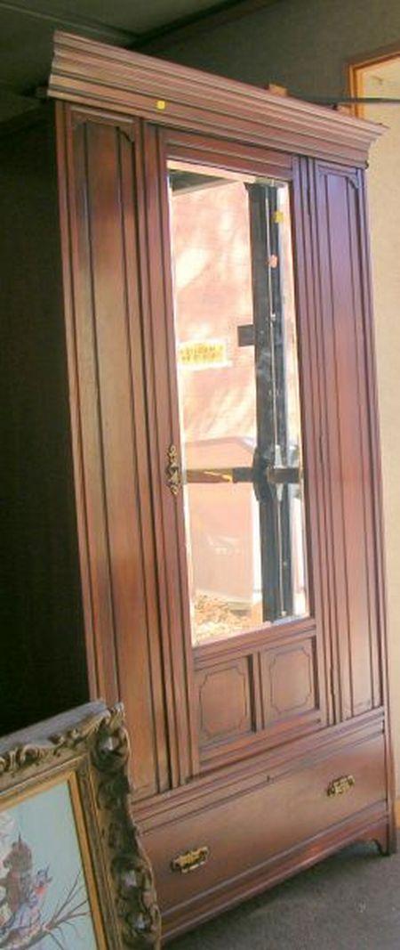Mirrored One-Door Armoire.
