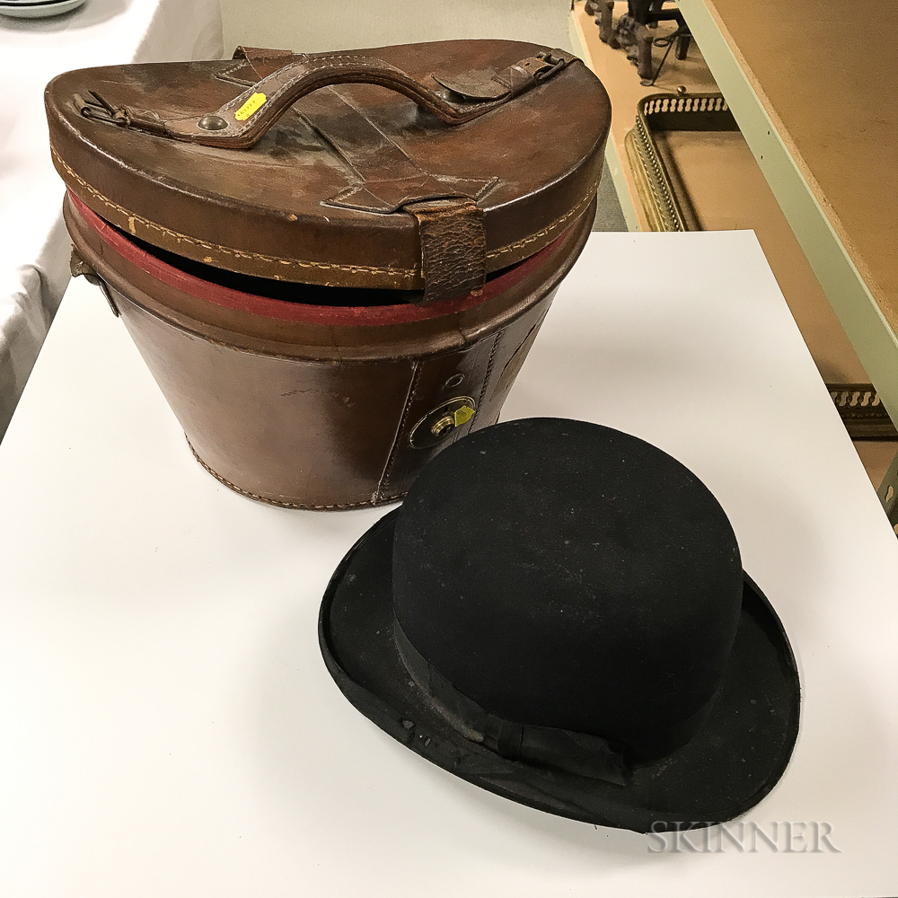Leather-cased Marexiano & Cie. Bowler Hat.