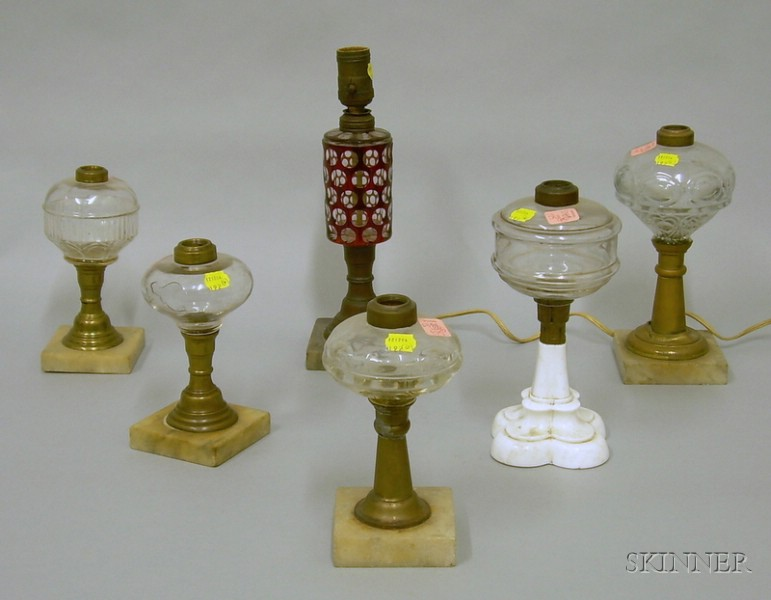 Six Glass and Metal Fluid Lamps