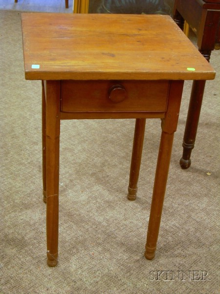Cherry One-Drawer Table with Turned Legs.