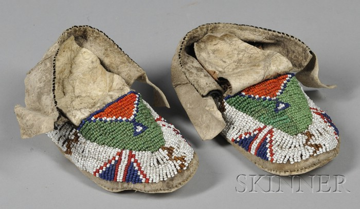 Pair of Native American Plains Childs Moccasins and a Contemporary Fetish Figure