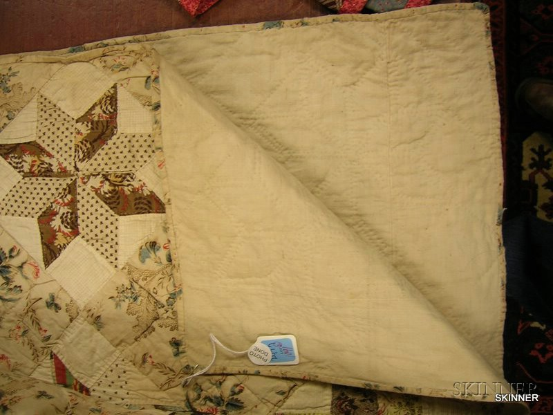 Two 19th Century Hand-stitched Pieced Cotton Quilts.      Estimate $300-500