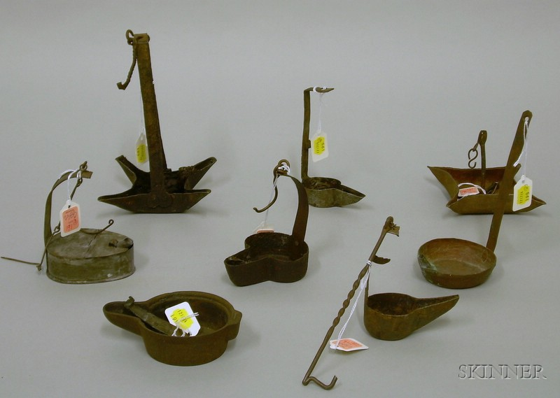 Eight Early Metal Grease and Oil Lamps