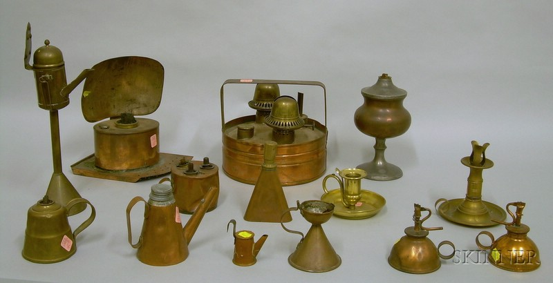 Fourteen Early Copper and Brass Lighting Devices