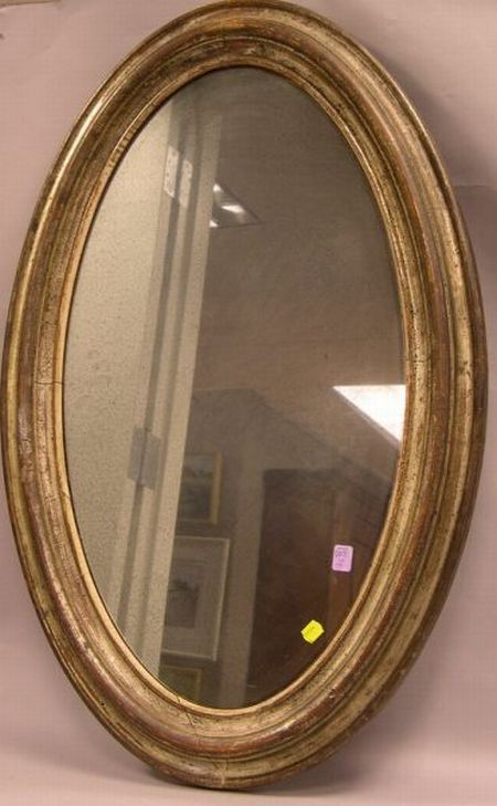 Oval Silver Gilt Molded Wood Mirror.