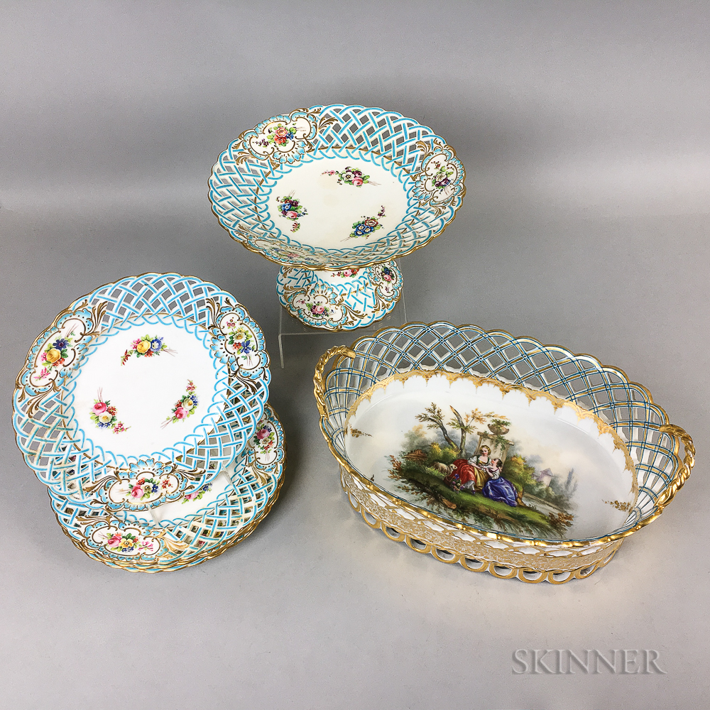 Set of Four Minton Reticulated Ceramic Plates, a Compote, and a Center Bowl.     Estimate $400-600