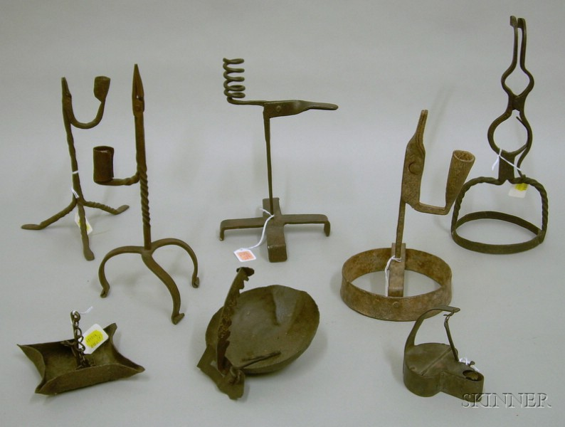 Eight Early Wrought Iron Lighting Devices