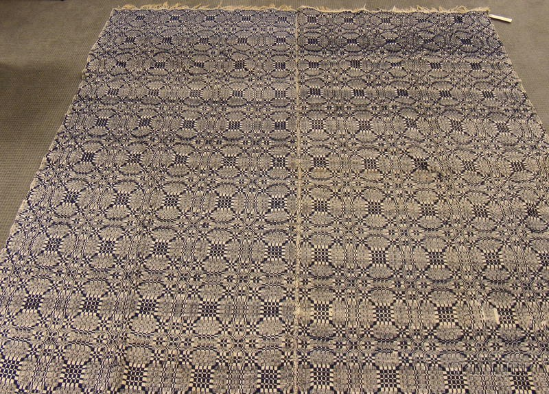Two Hooked Rugs, a Pieced Wool Log Cabin Pattern Coverlet, and a Blue and White Wool   and Cotton Woven Coverlet