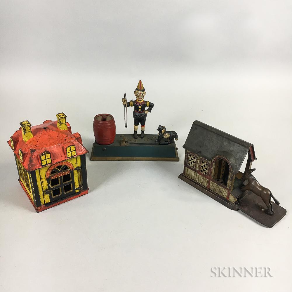 Three Polychrome Cast Iron Banks