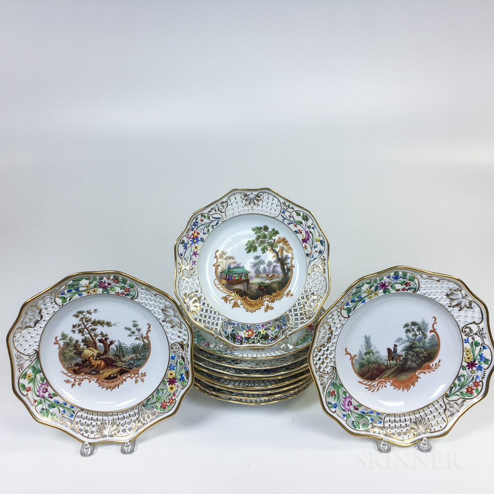 Assembled Set of Eleven Continental Reticulated Plates with Hunting Scenes