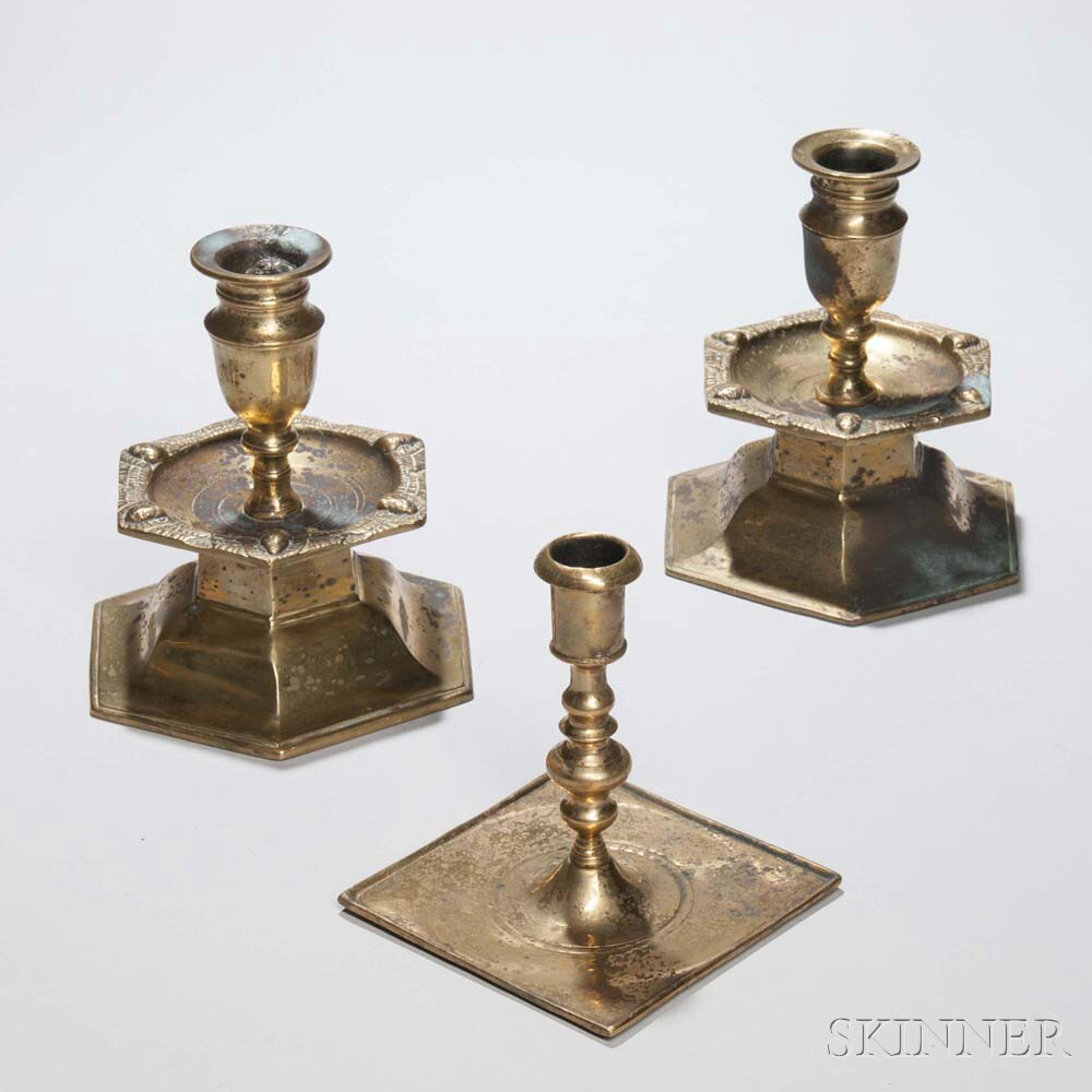 Pair of Continental Hexagonal Mid-drip Brass Candlesticks and a Single Square-base Candlestick