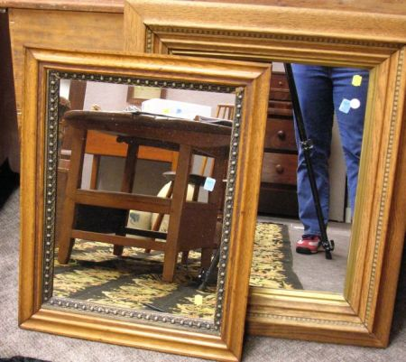 Two Late Victorian Oak Framed Mirrors.