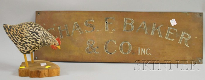"Brass Trade Sign ""Chas. F. Baker & Co. Inc.,"" and a Will Kirkpatrick Carved   and Painted Wooden Chicken Figure"