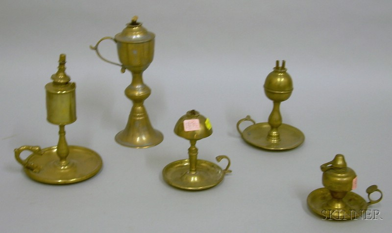 Five Chamber Lamps in Brass and Pewter.