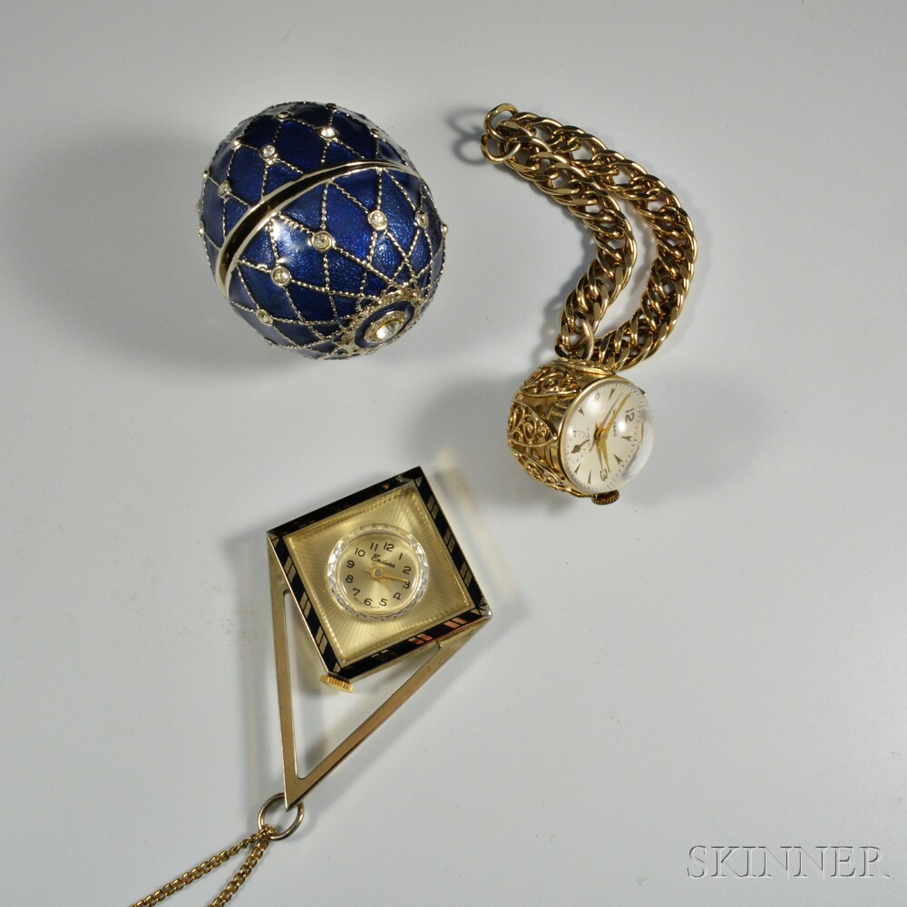 Welsboro Watch Bracelet, Geometric Endura Enameled Pendant, and a Watch in a Fabergé-style Enameled Egg.     Estimate $80-100