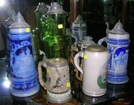 Eight Assorted Stoneware, Porcelain, and Glass Steins