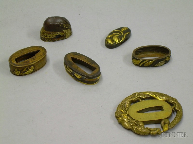Small Group of Japanese Sword Fittings.