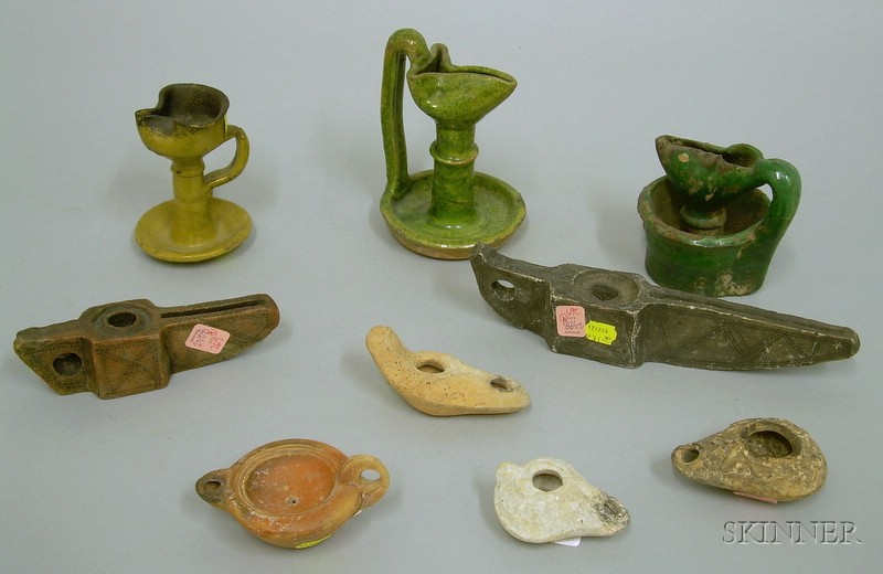 Nine Early Pottery and Stone Grease and Oil Burning Lamps
