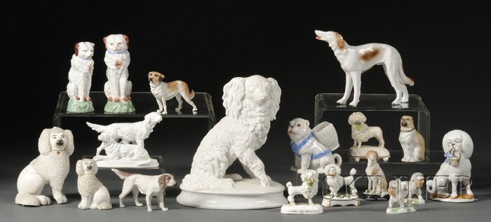 Eighteen English and Continental Bisque Porcelain Dog Figurines