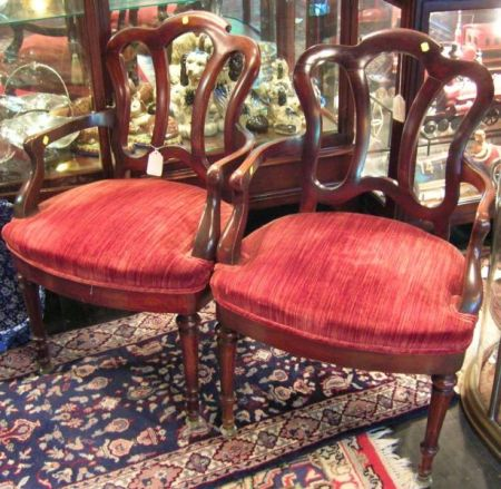 Pair of Late Victorian Rococo-style Walnut Open Armchairs