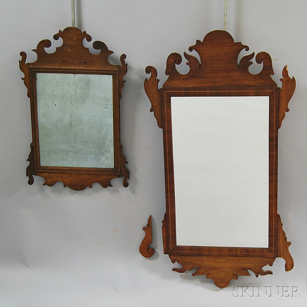 Two Chippendale Mahogany Scroll-frame Mirrors