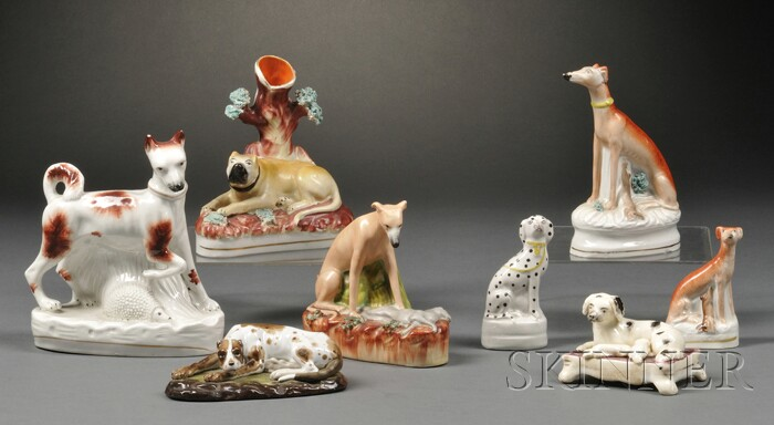 Eight Mostly Staffordshire Dog Figurines