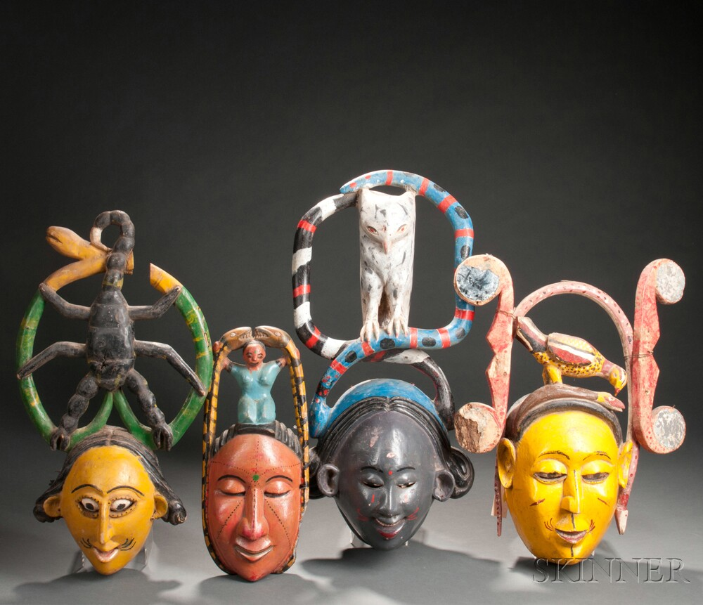Four Ibibio Polychrome Carved Wood Face Masks