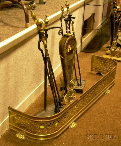 Brass Fireplace Fan, Four Pairs of Tongs, Two Tool Stands, and a Pierced Brass Fender.