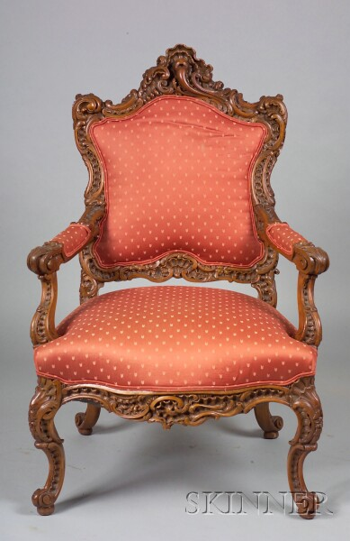 Fine Rococo Revival Carved Walnut Library Armchair