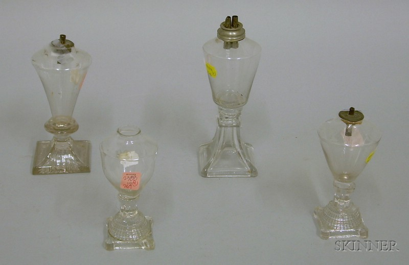 Four Small Free-blown Colorless Glass Lamps on Pressed Glass Bases