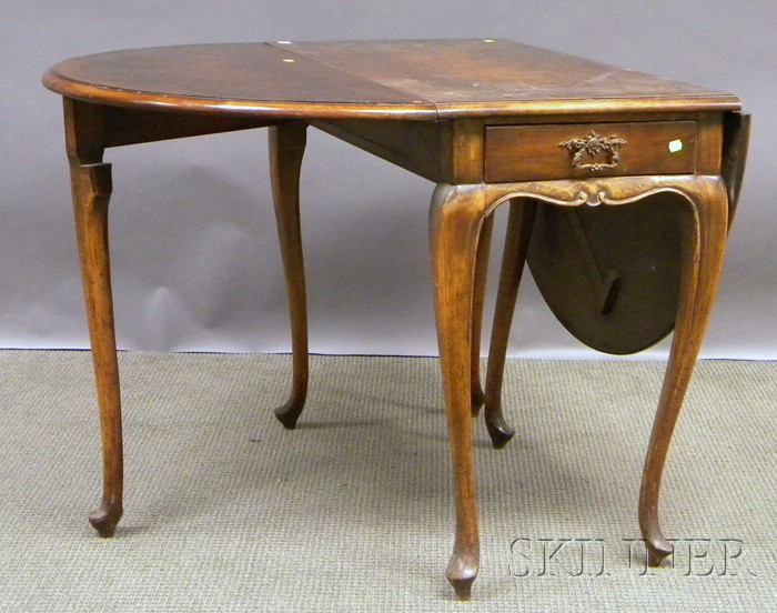 English Queen Anne-style Carved Walnut and Burlwood Veneer Drop-leaf Table.