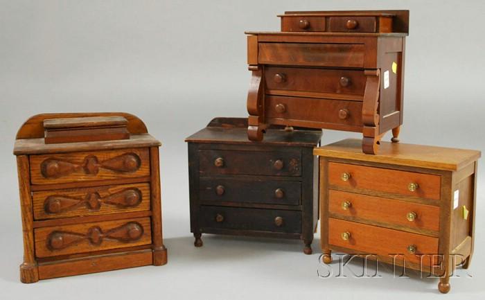 Four Miniature Wooden Toy Bureaus
