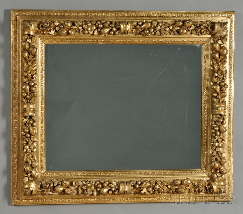 Carved Giltwood and Composite Mirror