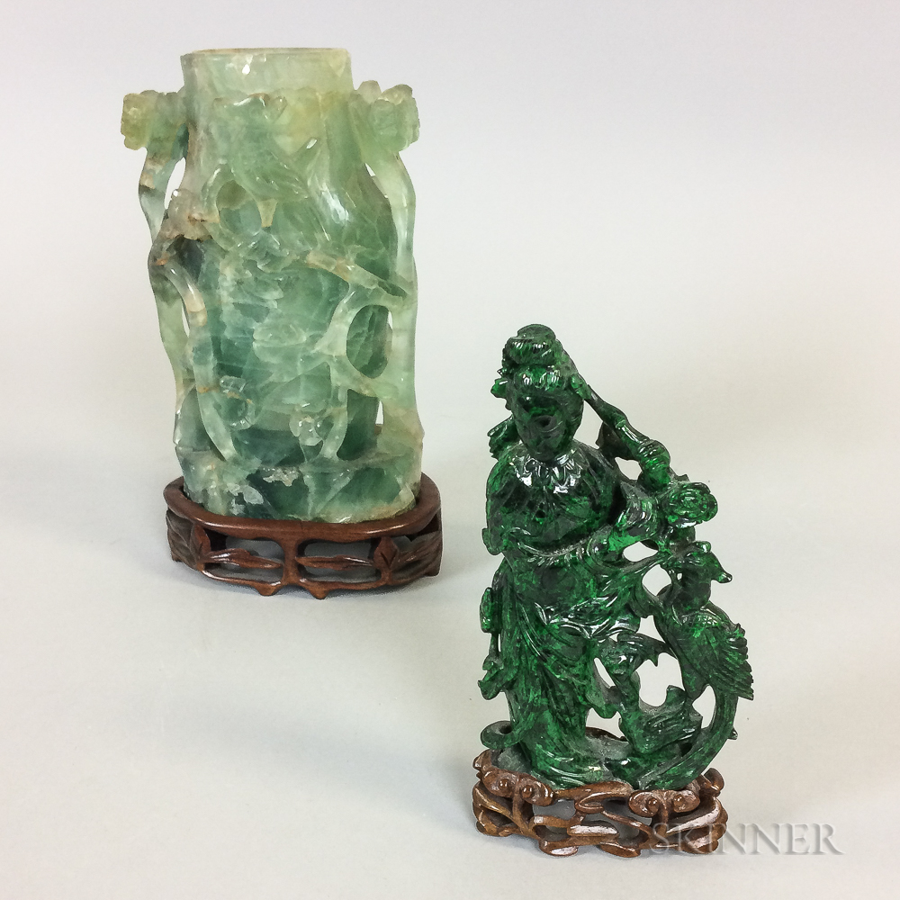 Two Green Carved Stone Figures on Wooden Stands
