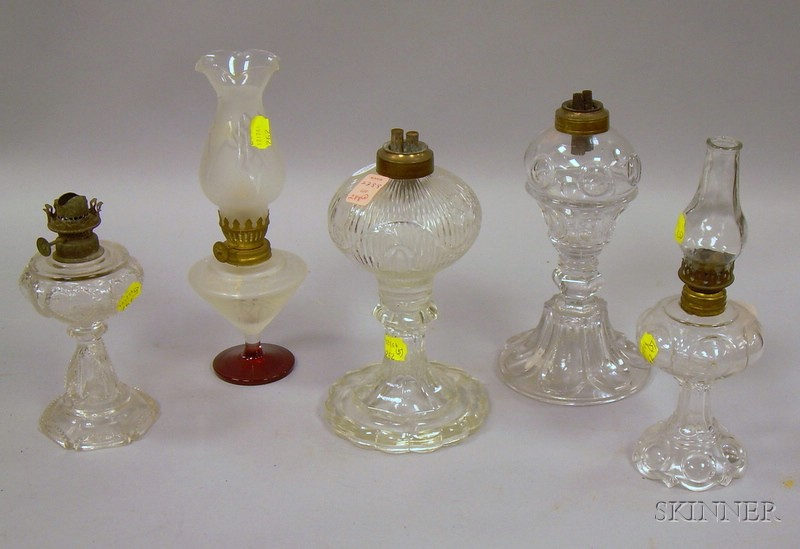 Three Small Colorless Pressed Glass Lamps and One Blown Molded Lamp