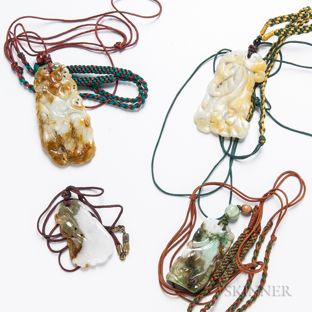 Four Carved Jadeite Pendants
