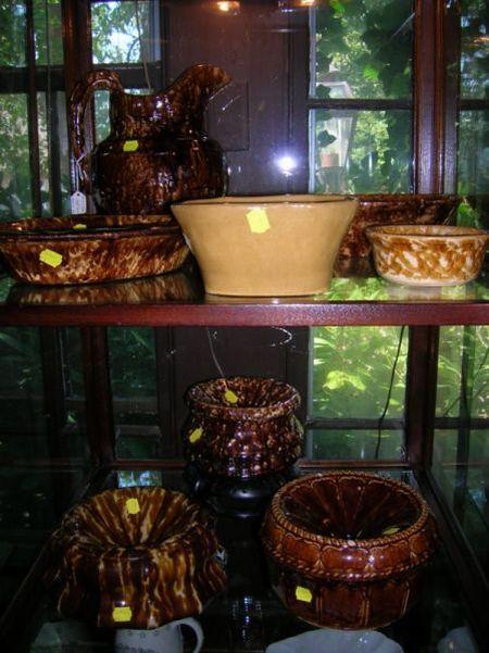 Eight Pieces of Bennington and Rockingham Brown Glazed Stoneware