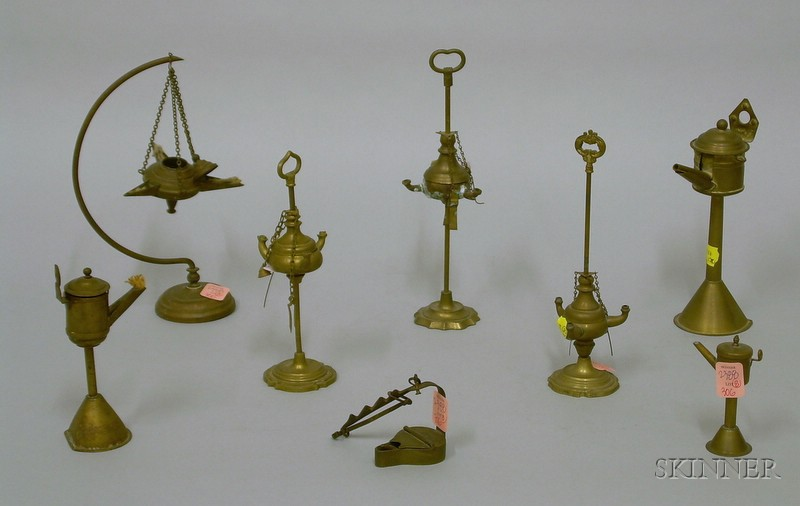 Eight Miniature Brass Lighting Devices