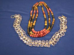 Triple-Strand of Hardstone Beads and a Strand of Crystal Beads.