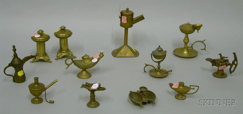 Twelve Assorted European Brass and Cast Metal Lighting Devices