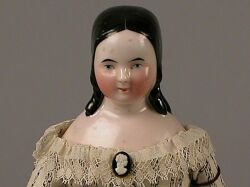 Small Pink-Toned China Doll with Long Molded Curls