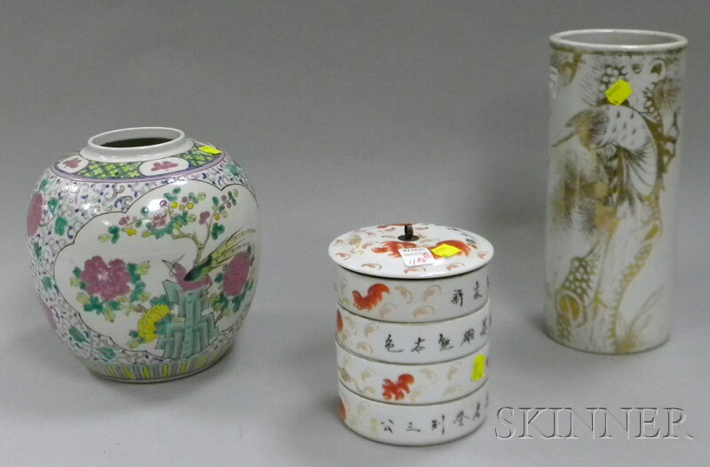 Chinese Decorated Porcelain Cylindrical Vase, Enamel-decorated Jar, and Four-stack   Food Container.     Estimate $500-700