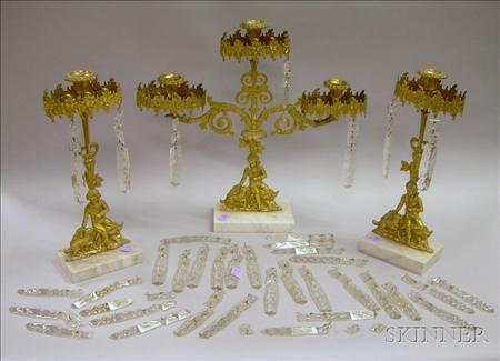 Three-piece Gilt Brass Figural Girandole Set with Prisms.