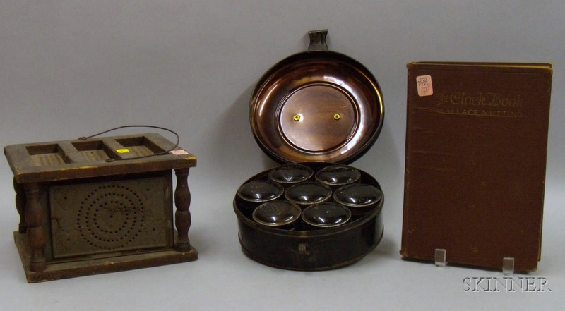 Pierced Tin and Wood Footwarmer, a Round Painted Tin Spice Box with Seven   Containers, and The Clock Book