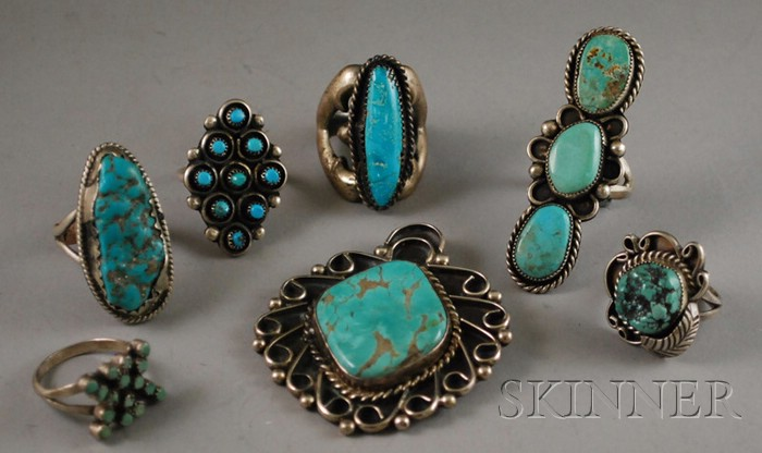 Six Southwestern Silver and Turquoise Rings and a Pendant.