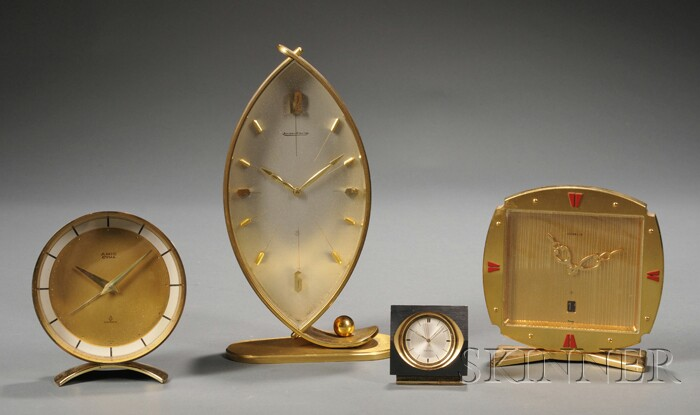 Four Brass Table Clocks