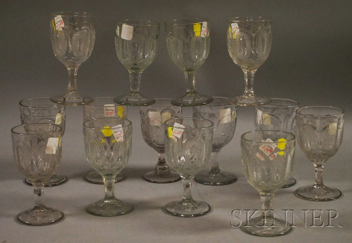 Fourteen Colorless Pressed Pattern Glass Goblets.
