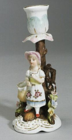 Small Glazed Porcelain Candleholder with a Child at Base