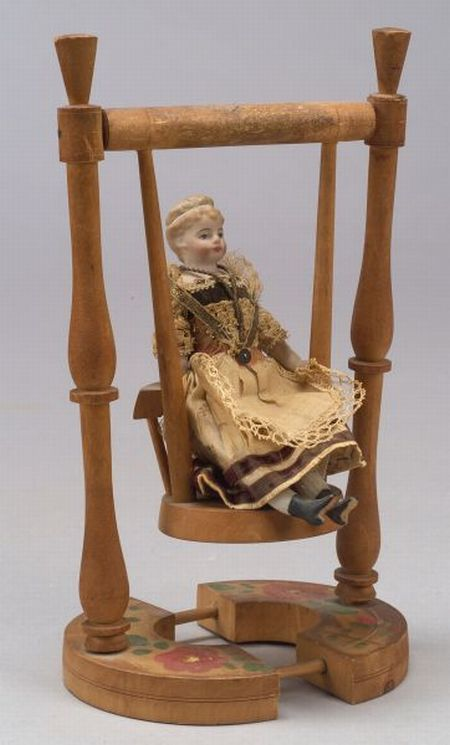 Small Bisque Shoulder Head Doll on Swing