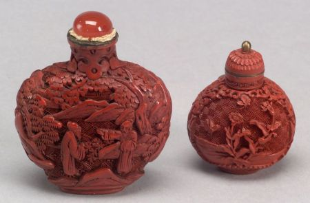 Two Carved Cinnabar Snuff Bottles